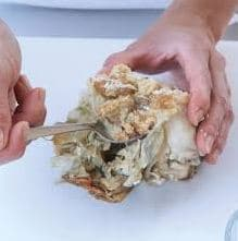 Remove the meat from the body of the Crab
